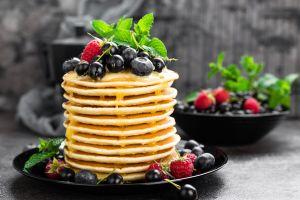 fruit raspberries food blueberries berries sweets pancakes syrup mint leaves