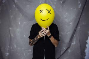 happy face black balloon smiley gray background happy tattoo smile tattoo sleeve yellow men hands photography gray shirt