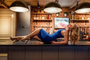 high heels closed eyes tight dress red nails blue dress fishnet stockings kitchen blonde women