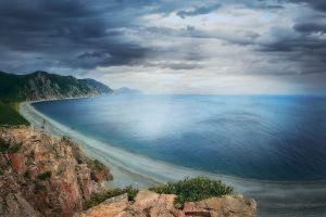 horizon beach clouds shore sea landscape cliff nature rock coast
