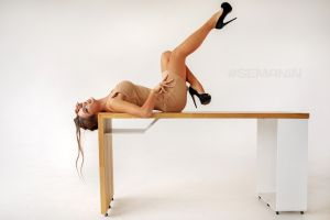 indoors high heels glasses side view dress feet in the air model daria shy legs up profile desk lying on back necklace brunette women indoors