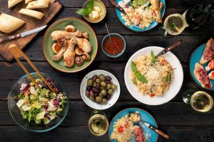 knife bread salad spoon olives food meat