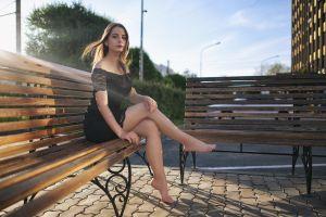 konstantin dmitrievich women sunlight dark eyes bench barefoot women outdoors black dress minidress sitting city long hair brunette bare shoulders lace