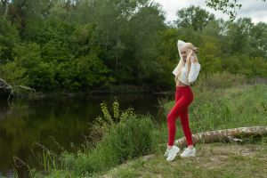leggings river women blonde smiling women outdoors red pants sneakers nature