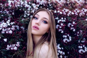 long eyelashes long hair women face blonde blue eyes make up flowers looking at viewer pink lipstick portrait