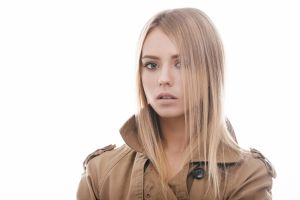 looking at viewer white background lip gloss straight hair portrait model open mouth women teeth hair in face simple background coats trench coat blonde pink lipstick