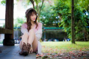 looking away long hair sitting smiling brunette women asian pink lipstick bokeh dress women outdoors pink dress model berets boots