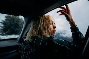 model blond hair car looking away