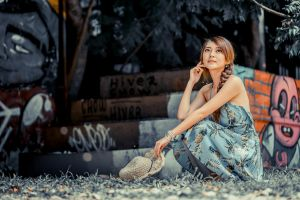 model straw hat brunette stairs asian dress graffiti women braided hair