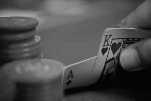 monochrome hands playing cards poker
