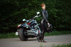 motorcycle leather jackets leather leggings boots leather clothing side view women outdoors alexandr chuprina short hair smiling outdoors looking at viewer black clothing women with motorcycles model