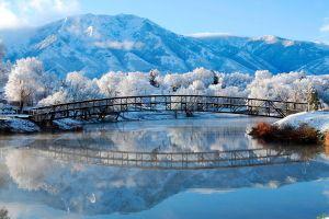 mountains snow reflection water winter bridge
