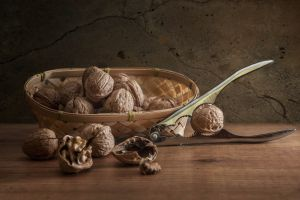 nuts wooden surface food walnuts