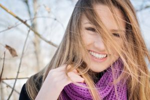 open mouth happiness smiling hair in face happy scarf women closeup blonde