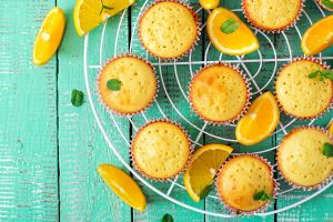 orange (fruit) wooden surface muffins food sweets mint leaves