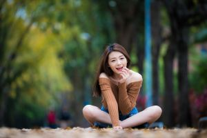 outdoors brunette happy sitting women outdoors sweater pink lipstick legs crossed long hair women portrait model smiling looking away bare shoulders
