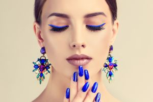 painted nails simple background makeup model women face
