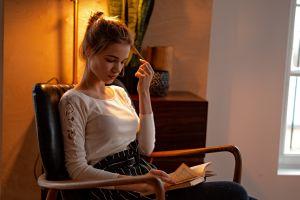 pantyhose window brunette sitting chair model reading indoors women indoors grigoriy lifin books blouses holding hair women skirt