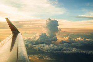 plane wing sky clouds aerial view sunset skyscape