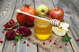 pomegranate fruit apples wooden surface food mint leaves honey