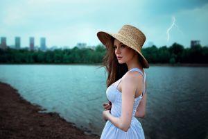 portrait hat thunderbolt lenar abdrakhmanov long hair brunette riverside women river looking into the distance dress women outdoors blue eyes