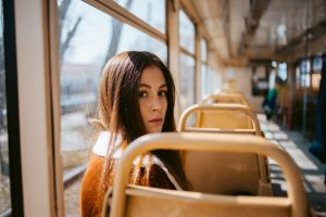 portrait looking back face tram brunette brown jacket sitting bomber jacket women dima minakin long hair coats brown eyes freckles jacket