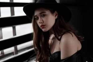 portrait red lipstick women indoors hat bare shoulders brunette zipper women with hats indoors black jackets black clothing looking at viewer model cleavage long hair