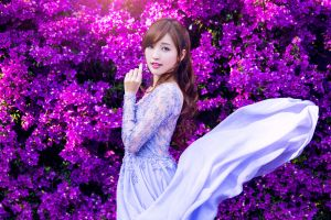 purple flowers dress colorful standing flowers women asian photography looking at viewer model