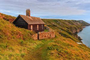 sea plants shore landscape clouds cliff house cabin grass nature path