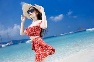 sea women outdoors women with shades shades hat asian model women