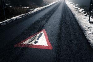 sign asphalt road winter