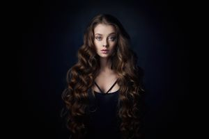 simple background portrait display model long hair dark face