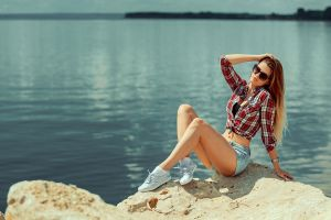 sitting long hair plaid shirt blonde aleksandr suhar sea women sunglasses white socks sneakers women outdoors jean shorts