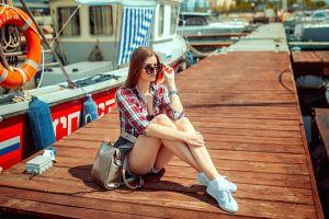 sneakers plaid shirt handbags sunglasses tiptoe blonde women pier boat jean shorts women outdoors sitting