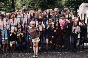 the beatles george harrison group of people yoko ono paul mccartney john lennon fence ringo starr children musician