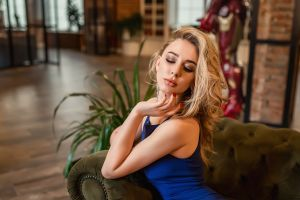 tight dress portrait sitting plants red nails blonde couch women blue dress