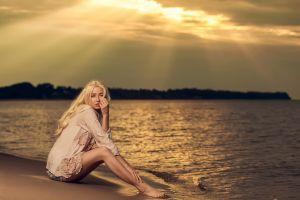 women outdoors barefoot outdoors sitting water long hair women sand blonde