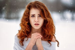 women outdoors long hair freckles women outdoors depth of field portrait curly hair face redhead snowing snow bare shoulders model