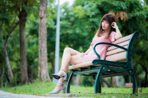 women outdoors urban model legs crossed sitting long hair women depth of field pink dress thinking asian brunette