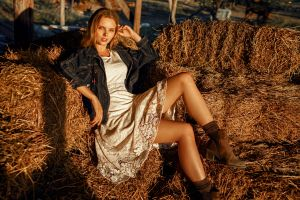 women outdoors women blonde sitting straw sunset jeans jacket outdoors white dress model dress boots georgy chernyadyev looking at viewer