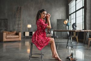 women sitting red nails depth of field looking at viewer model mariya volokh brunette red dress painted nails brown eyes barefoot women indoors couch pigtails