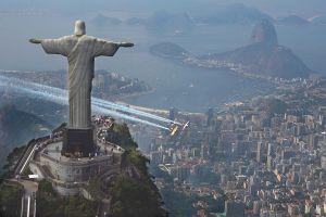 aerial view aircraft christ the redeemer rio de janeiro statue cityscape contrails