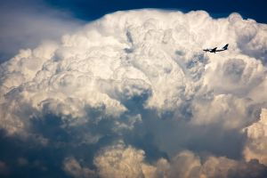 airplane aircraft clouds
