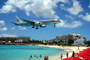 airplane beach aircraft sea