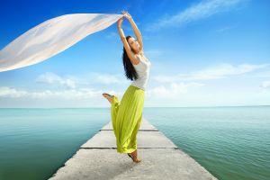 armpits women pier windy tank top sea long skirt brunette women outdoors arms up