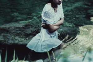 arms crossed water wet ripples arms on chest women outdoors wet body white dress women