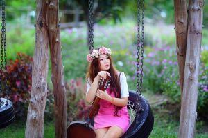 asian looking away pink dress sitting swings guitar wreaths musical instrument women outdoors women redhead