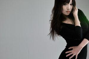 asian women black dress necklace simple background
