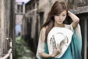 asian women outdoors urban model women hands on head