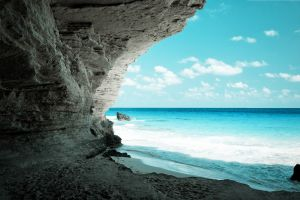 beach sea cliff horizon rock coast landscape clouds water nature